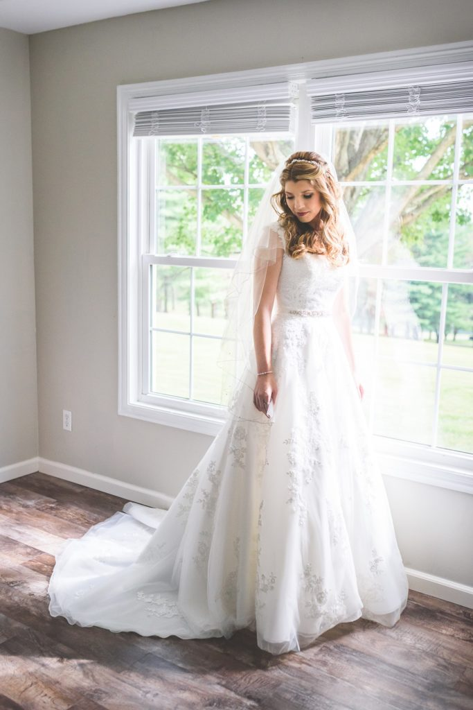 Wearing wedding dress